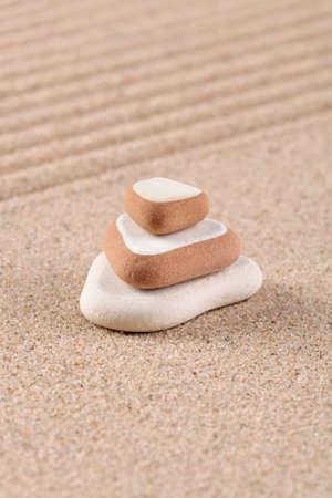 Three stones stacked on a raked sand zen garden. Stock Photo - 17833954