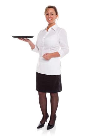 bandejas: Foto de cuerpo entero de una camarera que sostiene una bandeja vac�a, aislada en un fondo blanco Foto de archivo