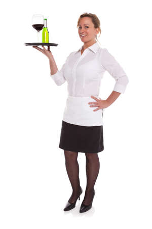 Full length photo of a waitress serving drinks on a tray, isolated on a white background. Stock Photo - 18207952
