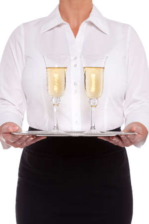 Waitress serving glasses of Champagne on a silver tray, isolated on a white background. Stock Photo - 18207957