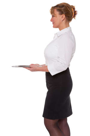 Waitress holding an empty silver tray, isolated on a white background. Good image for product placement. Stock Photo - 18207955