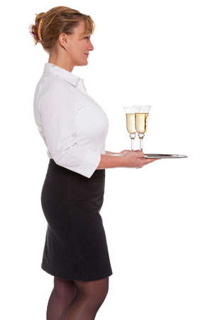 Profile of a waitress holding a silver tray with two glasses of Champagne, isolated on a white background. Stock Photo - 18207956