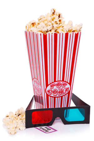 Box of Popcorn, 3D Glasses and an Admit One ticket isolated on a white background.  photo