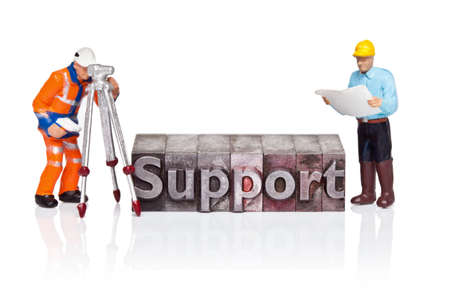 Hand painted figurines and the word Support in old metal letterpress isolated on a white background. Stock Photo - 18453488