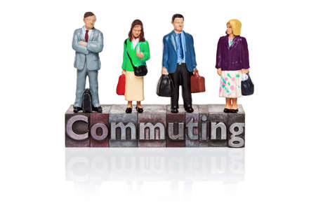 Hand painted commuters figurines and the word Commuting in old metal letterpress isolated on a white background. Stock Photo - 18453491