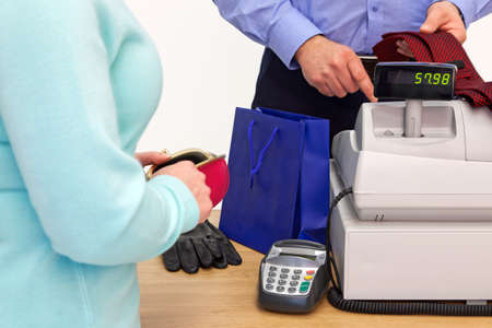 checkout: A woman at the store checkout  buying some gifts for a man Stock Photo