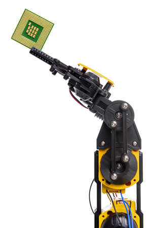 A robotic arm holding a computer chip isolated on a white background. photo