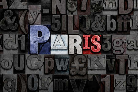 The word Paris made from old metal letterpress letters with the colours of the French flag Standard-Bild