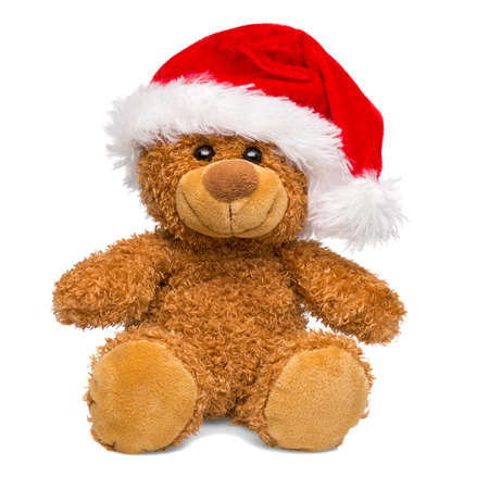 Christmas teddy bear wearing a Santa Claus hat isolated on white background, cut out. Standard-Bild