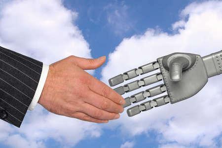 Handshake between a businessman and robotic hand, a meeting with technology concept. Standard-Bild
