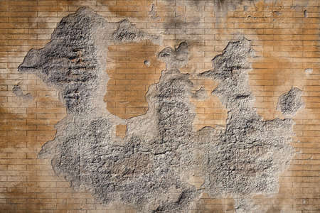 Weathered plaster and brick wall textured background