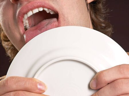 plate licking Stock Photo