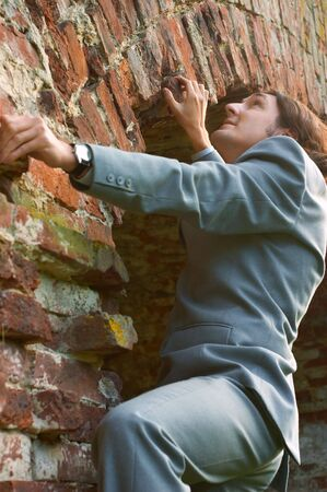 businessman climbing the wall photo