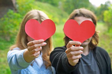 couple holdin hearts Stock Photo