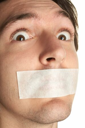 silenced: scared man with gag Stock Photo