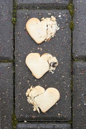 three broken hearts on asphalt photo