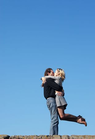 couple strong kissing under the sky