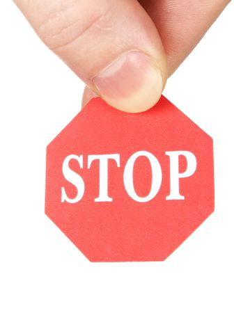 fingers holding stop sign Stock Photo