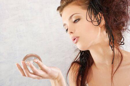 girl holding glass sphere Stock Photo