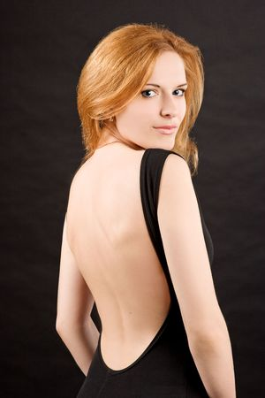 sexy redhead woman in black dress