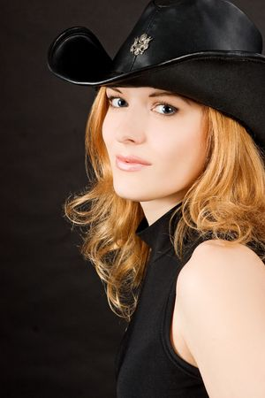 sexy redhead woman in black hat photo