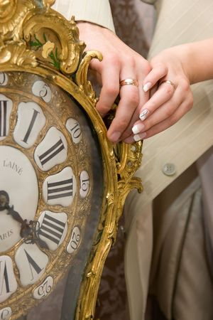 married couple hands on old clock Stock Photo - 3671800