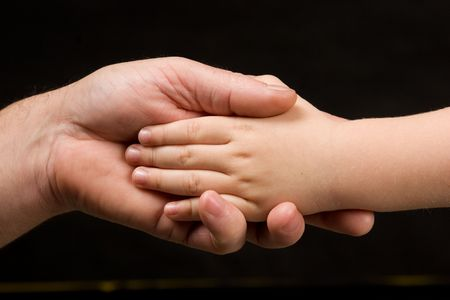 adult pulm holding childs hand photo