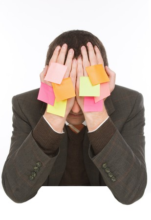 businessman hiding behind hands with many stickers photo