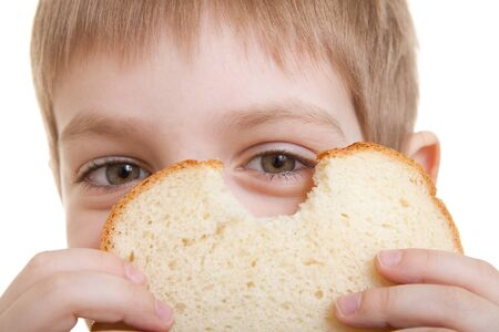 Boy looking through piece of bread Stock Photo