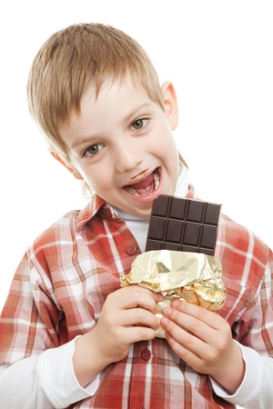 boy biting bar of chocolate Stock Photo - 9469457