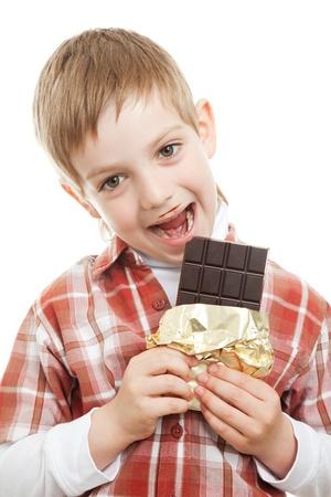 boy biting bar of chocolate Stock Photo - 9469457