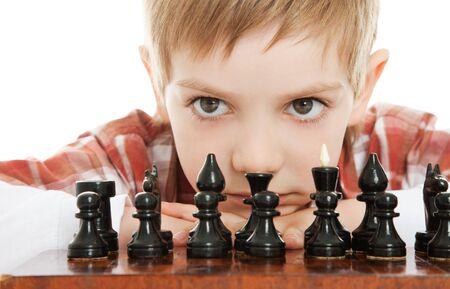 boy playng chess close up Stock Photo