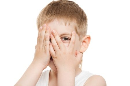 boy peeping out through fingers Stock Photo - 9608863