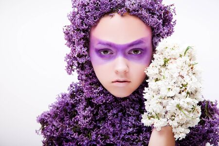 girl face close up: dressed with  lilac beauty