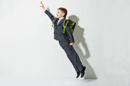 School boy flying photo