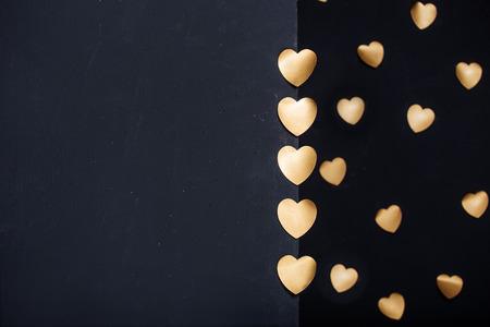 gold textured background: Gold heart stickers over dark textured background