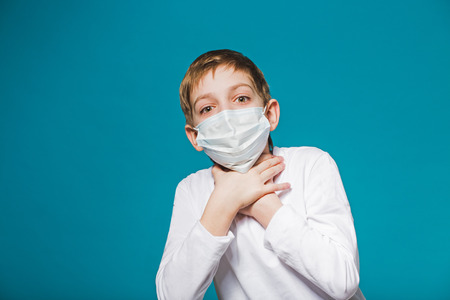 suffocate: Boy wearing protection mask is short of breath