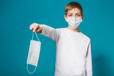 Boy wearing protection mask suggesting mask Stock Photo
