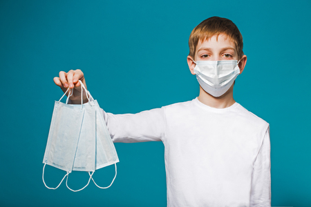 suffocate: Boy wearing protection mask suggesting masks Stock Photo