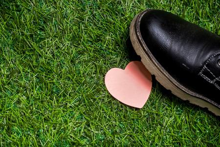 heartbreaker: Heart lying on the grass tramled by big black boots