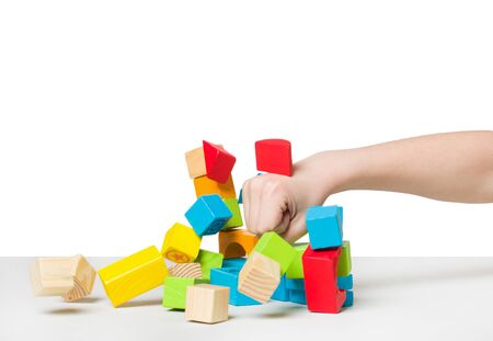 Hand beating house made of color wooden blocks photo