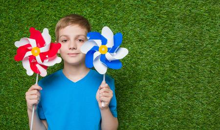 pinwheels: Smiling boy holding pinwheels