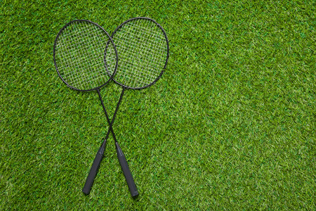 competitive sport: Badminton rackets lying on the grass Stock Photo