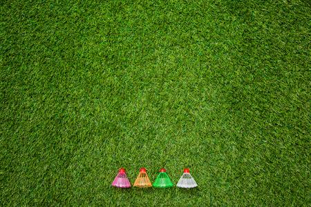 entertainment equipment: Badminton shutlecocks lying on grass Stock Photo
