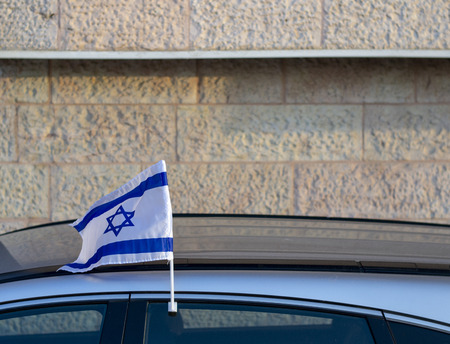 Israeli flag mounted on a car window during the Israel independence day celebrations Stock Photo