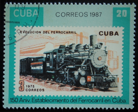 Collectible postage stamp with old trains from Cuba photo