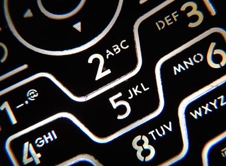 backlit keyboard: Closeup of a phone keypad with keys backlight