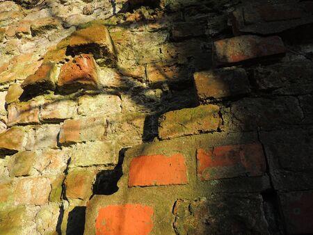 angular: Angular structure of an old ruined brick wall