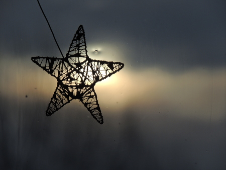 star ornament: Star ornament made of wire with dawn in the background