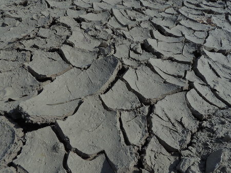 fractures: Dried ground cracks and fractures into pieces